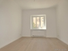 ROOMS4 - top 3 Zimmerwohnung mit großem Balkon und Lift in charmanten Stadthaus - Wohnzimmer unmöbliert